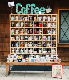 How sweet is this coffee mug station? An array of vintage coffee mugs make up this wedding favor display!