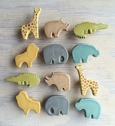 Save $18 on the set of 12: one left/right facing knob of each animal shown!  A modern take on a nursery classic. These handmade ceramic furniture