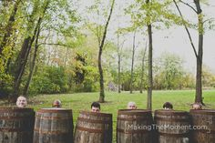 Groosmen in wine barrels     http://www.makingthemoment.com/blog/2012/a-mon-ami-winery-wedding