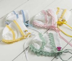 A pile of heirloom hankies is often tossed aside with no real purpose or use for them. Transform those delicate hankies into a precious gift using the Heirloom Hankie Baby Bonnets pattern. If you don't have heirloom hankies to use, purchase new ones and turn them into a cherished heirloom gift. The pattern includes instructions to add dainty yellow, green, pink and blue embellishments to the hankie bonnets. Elegant touches are increased when you add ribbon, roses and pearl beads to acc