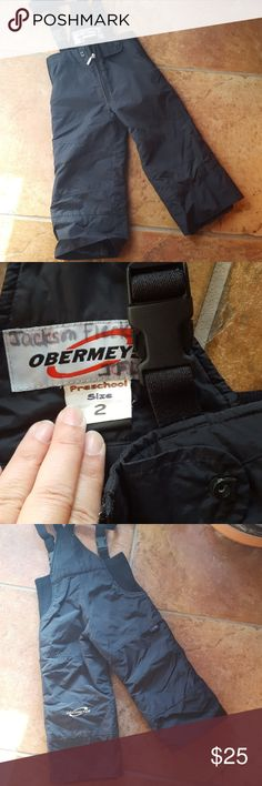 OBERMEYER   unisex black ski /snow suit OBERMEYER  unisex black ski /snow suit great brand this is in great condition but as you can see someone's name is on the tag size 2 keeps really warm/dry OBERMEYER Other