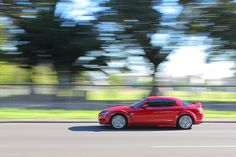 This photograph is a great example of how photographers can achieve implied movement. By blurring the background of the photo and focusing in on the car we get a sense that the car is moving.    http://www.cambridgeincolour.com/tutorials/depth-of-field.htm