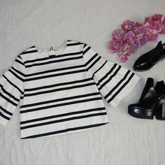 ZARA TRAFALUC Crop Top Dressy black and white striped crop top with bell sleeves. Super cute for a night out! Rear zip. Cotton/polyester/elastane blend. Never been worn but has blemishes from trying on and storage (see last image). Zara Tops Crop Tops