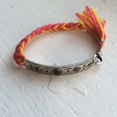 Metal and rope bracelet Worn 2x if that, no flaws. Metal is supposed to look worn. Just not my colors! Not sure of brand. Price firm unless bundled. Jewelry Bracelets