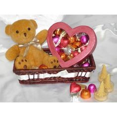 This gift basket is perfect for sharing. Overflowing wide range of gifts, it includes beautiful heart shape chocolate box with 20 mouth-melting chocolates, adorable teddy and tree candles all admirably arranged in a red cane basket. An ideal gift for weddings, anniversaries, special occasions or on your better half's birthdays. check this out: http://www.giftxoxo.com/send-chocolates/homemade-chocolates/bountiful-gift-basket-5006