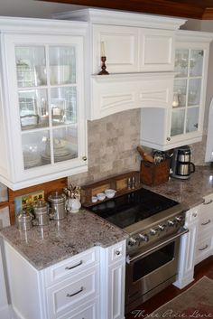 White cabinets with tile backsplash