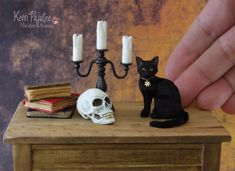 Black Cat, Candelabra & Skull. Cat is an original freehand sculpt of polyclay, wire paint & silk fibers. Skull prop made from polyclay & paint w/ a few gold teeth.