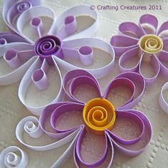 So pretty! Quilled flowers are a great addition to tags, cards, scrapbook pages, etc.