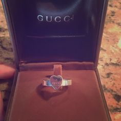 Gucci Sterling Silver Heart Ring Authentic Gucci heart ring! Sterling silver, minor scratches from normal wear. No real damage!! Comes with original box Gucci Jewelry Rings