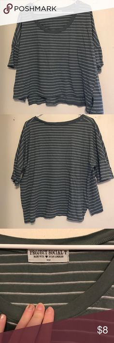 Grey and white stripe loose fitting cropped tee Boat neck style, hits at waist so not totally cropped but not long either. Flows and looks cute with boyfriend jeans! From urban project social t Tops Tees - Short Sleeve
