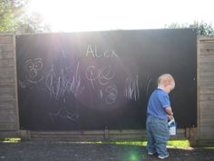 Garden chalkboard. Made by me using a sheet of external plywood from the local timber yard, plus 3 coats of blackboard paint. This has been a massive hit and Alex always asks for his chalks when outside.