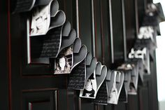 cute photo idea using cookie cutter hearts covered with photos and strung to make a garland.