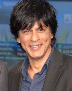 I just love his smile....dimples, crooked teeth and all!  That's what MAKES him ShahRukh! Tom Cruise was WRONG to change his teeth....it changed his looks and not for the better imho.  If it's working, DON'T change it!   And ShahRukh's WORKS for him!  ;-)