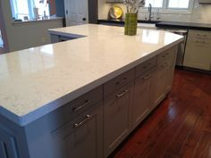 """Our Kitchen Makeover- Carrera marble looking surface without having to deal with the marble! Marble is nearly impossible to deal with in a kitchen because of how porous it is. It will stain, change colors if spilled on and scratch. Kids and marble don't mix! So, I hunted for the most realistic look alike to marble. We decided on a Cambria Quartz product called """"Torquay""""."""