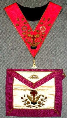 Sale B141015 Lot 95  A Rose Croix Masonic apron and collar, heavily embroidered, the collar suspended with a gemset jewel by Spencer of London, together with a leather bound booklet The Directions and Plans for the ceremonies of the Rose Croix of Heredom, all contained in a leather case  - Cheffins