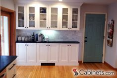 Glass inserts were added into these Shaker II Maple Bright White cabinets to add dimension and character. Black Kitchen Countertops, White Kitchen Cabinets, Discount Cabinets, White Shaker Kitchen, Shaker Style Cabinets, Cabinets Online, Basement Kitchen, Home Kitchens, Kitchen Remodel