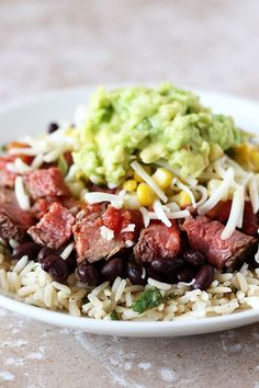 This Steak Burrito Bowl copycat recipe is loaded with beans, healthy cilantro lime brown rice, sweet corn salsa, and chunks of slightly spicy steak. Beef Recipes, Mexican Food Recipes, Cooking Recipes, Healthy Recipes, Leftover Steak Recipes, Healthy Food, Dinner Recipes, Healthy Eating, Spanish Recipes