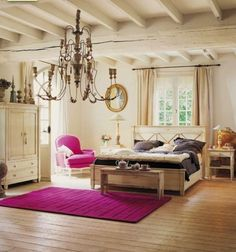obsessed with this perfect pop of fuchsia in such a muted rustic room.  Love the open space here and the window light above the bed. <3