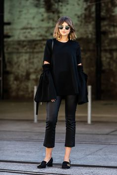 all black look with bell sleeves, cropped pants and heeled loafers