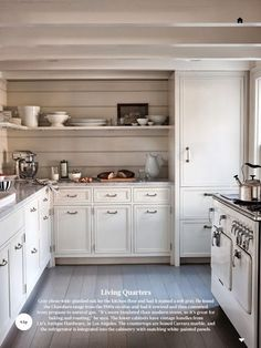 Wide-plank oak floors stained a soft gray add a comfortable, weathered look to this cottage kitchen.