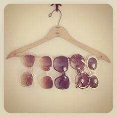 DIY - Great idea for hanging sunglasses! Make it even cuter by painting the wooden hanger!