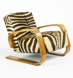 Alvar Aalto Tanklounge chair, model 37/400. Manufactured byArtek,Finland , 1936/c. 1945. Birch plywood and zebra hide. / Wright Auctions