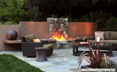 Exterior: Contemporary Patio In Outdoor Open Fireplace Design Combined With Double Bench And Centered Fire Pits In Stony Wall Accented By Candle Light Gave Romantic Nuance Also Colourful Paved Slab Outdoor Stone Fireplaces, Outdoor Fireplace Designs, Backyard Fireplace, Gas Fireplaces, Fireplace Outdoor, Outdoor Rooms, Outdoor Living, Outdoor Decor, Outdoor Lounge