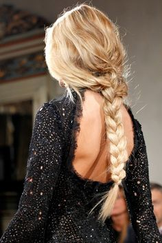 I am obsessed with this long thick blonde braid. Love the messiness at the head to the neatness going down the tail. Xo.