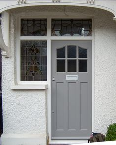 A light grey front entrance door with new frame. All bespoke craftmenship ensuring first class warmth, longevity and strength Grey Front Doors, Front Door Porch, Wooden Front Doors, Front Door Entrance, House Front Door, Front Door Colors, Glass Front Door, Entry Doors, Entrance Ideas