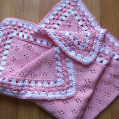 A beautiful knitted and crocheted baby blanket made using 100% cotton.   The knitted centre is pink and the edge is crocheted in pink and white. This is ideal for covering baby when in a car/carry seat or rocker chair or for a premature baby.   I made these for my daughter when she complained that larger blankets were awkward and hung over the edge of a carry seat, often dragging on the floor.   I started using cotton because babies have such sensitive and delicate skin.   This blanket…