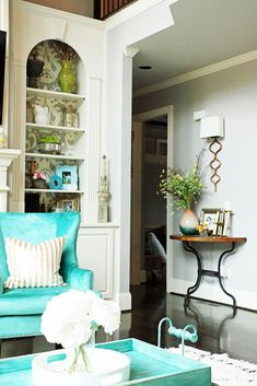 I want that teal chair...Beautiful.