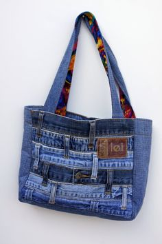 If you want to carry around a purse that no-one else will have, this unique denim purse is made from the waistbands of multiple upcycled jeans. There are 4 inside pockets made using the accent fabric (could also be made with denim if preferred). Sacs Tote Bags, Denim Tote Bags, Denim Purse, Denim Jeans, Denim Handbags, Purses And Handbags, Louis Vuitton Taschen, Blue Jean Purses, Mini Backpack Purse