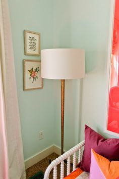 Jane's Room Reveal! Paint color is Stillness by Valspar. As a trick in disguising the small bed, used this beautiful floor lamp in the corner of the room. The Dumont Floor Lamp does a great job of drawing the eye up and love the hint of gold it brings to the space.