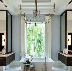Window, chandelier.  What is it about a free standing tub?  Beautiful!
