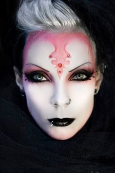 """Creature of fire"" make-up with crystal enhancements."