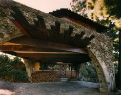 An office space is tucked under the arch spanning the driveway.