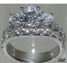 Sterling Silver .925 - 3 Stone Engagement-bridal Set * Size 7 *. Sterling Silver .925 - 3 Stone Engagement-bridal Set * Size 7 * on Tradesy Weddings (formerly Recycled Bride), the world's largest wedding marketplace. Price $74.62...Could You Get it For Less? Click Now to Find Out!