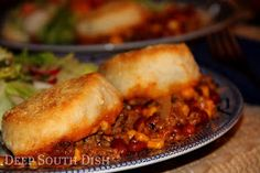 A hardy casserole of ground beef, seasoned with onion and bell pepper, some beans and corn, a little mixture of chili seasonings and topped off with rustic, cornmeal dusted biscuits.