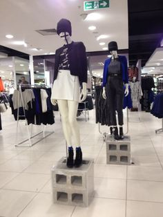Electrical tape 'check' on mannequin grouping in Arthaus