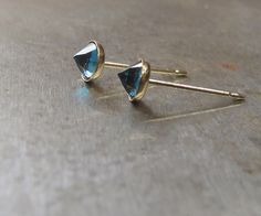 faceted london blue topaz stud, post earrings, bullet studs, blue gemstone studs, everyday earrings, cartilage and robe studs, gold earrings by sticksandstonesny on Etsy https://www.etsy.com/uk/listing/150679936/faceted-london-blue-topaz-stud-post