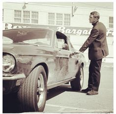 Steve McQueen...when i seen him in the car seen...when i got my drivers license i bought the same car...