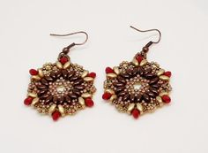 Round gold brown and red beaded earrings on by BeadedByLijana