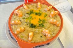 Shrimps - Portuguese açorda de camarãoes  (a tasty stew of shrimp, garlic and cilantro thickened with bread crumbs http://www.lonelyplanet.com/portugal