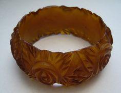 Vintage carved flowers bakelite  bangle by ThePlasticFever  on etsy.com