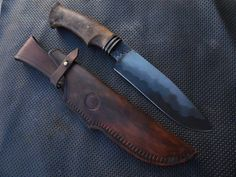 Luca Bubu Garanti 5 ply blade composed of fe 37, 15n20, O2 stabilized and oak handles bronze collar. Tanned scabbard