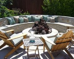 Stone patio wall / patio bench. Fire pit.
