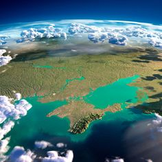 Exaggerated relief map of Crimea and the surrounding area - with clouds and an illuminated Black Sea