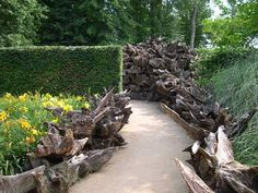 natural garden design with stumpery yard decorations- this one would be great at halloween