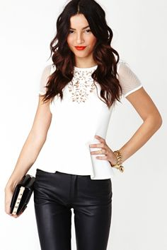 """The cutest white neoprene peplum top featuring laser cut detailing at front and a sheer mesh back. Exposed gold zip closure. Looks sweet withskinnies and lucite heels!  *17"""" bust  *12.5"""" waist  *22.5'' length  *Model is wearing size small  *Measurements taken from size small"""