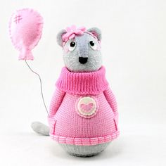 """Marilla the Mouse with balloon by SewinthemomentMarilla was born in the church vestry. She has been a church mouse ever since. She loves the melodic tones of the preacher's voice as he delivers his weekly sermon. Marilla sings along with the choir as they sing their songs of worship. She loves harmonising and she has a lovely alto voice. What Marilla likes best is the lull that happens in the sanctuary when everyone leaves. It is there that she feels at home. """"Ah home"""" Marilla whispers."""